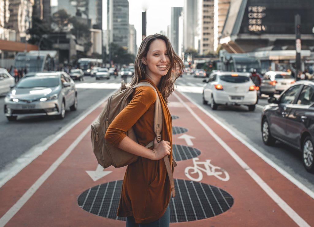 smiling solo female traveler